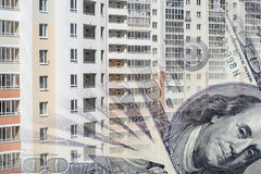 The facade of a tall building in the background of the Bank bills . Royalty Free Stock Photo