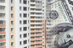 The facade of a tall building in the background of the Bank bills . The concept of development of the real estate market Stock Photos