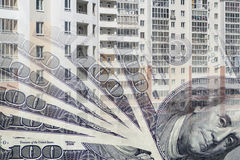 The facade of a tall building in the background of the Bank bills . The concept of development of the real estate market Stock Images