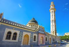 Minaret tower of mosque in old town Nabeul. Tunisia, North Afric. Facade and tall minaret tower of mosque in Nabeul. Tunisia, North Africa stock images