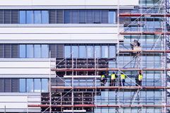 Facade thermal insulation works. Industrial background of big city Royalty Free Stock Photography