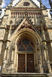 Facade of Thomaskirche in Leipzig. Leipzig, Germany – April 8, 2016. Facade of Thomaskirche in Leipzig, with portal, wooden door and rose windows above the Stock Photos