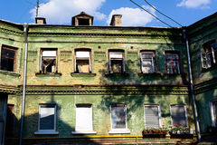 Facade of the three-storey green brick building.  Stock Photography