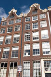 Facade of tipical Amsterdam architecture and appartments in Amsterdam, Netherlands. Royalty Free Stock Images