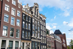 Facade of tipical Amsterdam architecture and appartments in Amsterdam, Netherlands. Stock Photo