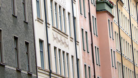 Facade of townhouses. Pastel-colored facade of townhouses stock photography