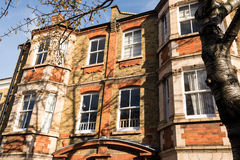 Facade of a traditional British Victorian tenement flat Stock Image