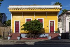 The facade of a traditional colorful house in the Marigny neighborhood in the city of New Orleans, Louisiana. USA stock image