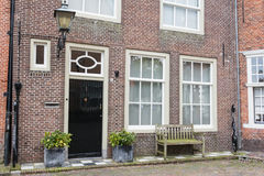 Facade of a traditional dutch village house Stock Images