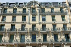 Facade of Traditional French Riviera Building. Facade of Traditional Building of French Riviera With Many Windows And Balconies Royalty Free Stock Photo