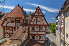 Traditional German half timbered house, old city and the square Tiergaertnertorplatz Nuremberg, Bavaria, Germany. Facade of traditional German half timbered stock photography