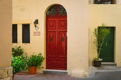 Facade of traditional maltese house in Rabat. Rabat, Malta - March 10 2017:  Facade of traditional maltese house in Rabat with massive wooden doors and house`s Royalty Free Stock Photos