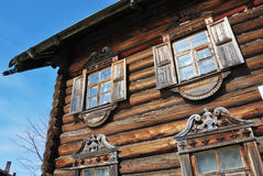 Facade of the traditional russian wooden house Stock Images