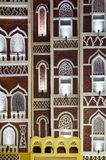 Facade of traditional Yemen architecture. Facade with windows of traditional Yemen architecture in red brick Stock Photography