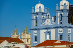 Facade of two churchs in Angra do Heroismo, Island of Terceira, Azores. Long shot view of blue and cream facade in churchs in Angra do Heroismo, Island of royalty free stock photography