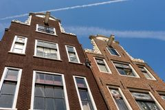 The facade of two historical Dutch houses. The characteristic facade of two historical Dutch houses in the center of Amsterdam in the Netherlands royalty free stock photos