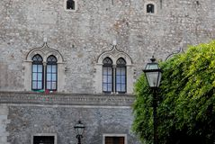 Facade, with two twin windows, in a historic building in Syracuse in Sicily Stock Photography