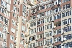 The facade of a typical block multi-storey residential building. Front view close up Stock Images
