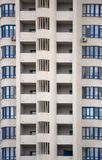 The facade of a typical block multi-storey residential building. Front view close up Royalty Free Stock Photos