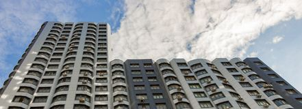 The facade of a typical block multi-storey residential building. Front view close up Stock Photography