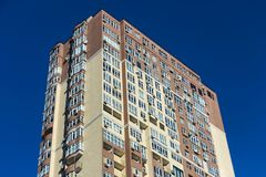 The facade of a typical block multi-storey residential building. Front view close up Stock Photos