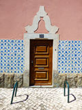 Facade of a typical Portuguese house decorated with vintage Portuguese tiles azulejos Stock Photos