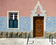 Facade of a typical Portuguese house decorated with vintage Portuguese tiles azulejos Stock Photography