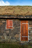 Facade of a typical rural building with natural grass roof   Royalty Free Stock Photos