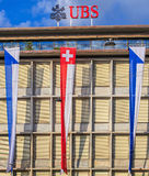 Facade of the UBS building decorated with flags Stock Images