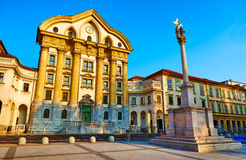 Facade of the Ursuline Holy Trinity church on Congress square - baroque monument, Ljubljana, Slovenia. Stock Photos