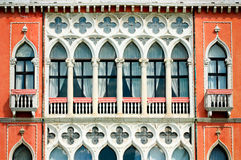 Facade of a venetian building. Bright orange facade of venetian style house Stock Images