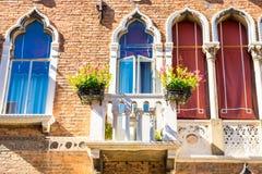 Facade with Venetian windows and balkony in Venice