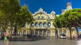 Facade view of Port de Barcelona building timelapse hyperlapse, historical old custom port building view in Barcelona stock video footage