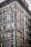 Facade on vintage New York City apartment building. Corner facade on vintage New York City apartment building with brick and windows Stock Image