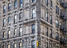 Facade on vintage New York City apartment building. Corner facade on vintage New York City apartment building with brick and windows Royalty Free Stock Photography