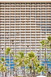 Facade of Waikiki hotel with palms in Honolulu Royalty Free Stock Photography