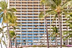 Facade of Waikiki hotel with palms in Honolulu Royalty Free Stock Photos
