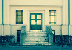Facade of white house with green doors and stair, Austria Stock Photography