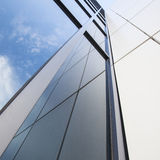 Facade of white office building with blue sky Stock Photo