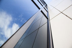 Facade of white office building with blue sky Royalty Free Stock Images