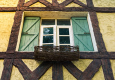 Facade window. Facade of cottage house with window in vintage tone, selective focus royalty free stock photo