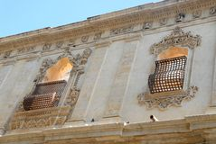 Facade with window and door of an elegant building in Noto in Sicily (Italy) Stock Images