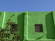 Facade with window painted green stock photography