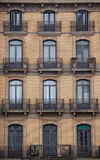 Facade with windows and balconies, historic building. Barcelona city. Spain Royalty Free Stock Images