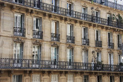 Facade, Windows and balconies of the houses in the centre of Paris, Royalty Free Stock Photos