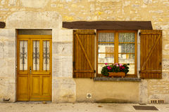 Facade wood shutters and flowers Cajarc royalty free stock photo