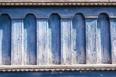 Facade of a wooden house. Carved facade of a wooden house with peeling paint Stock Photo