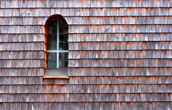 Facade. Wooden shingle facade with window royalty free stock photos