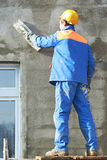 Facade worker plastering wall Royalty Free Stock Images