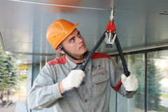 Facade worker with rivet tool. Worker builder doing facade works with Heavy Duty Lever Type Hand Rivet Tool Royalty Free Stock Photo